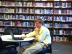 Grant works diligently in the library.