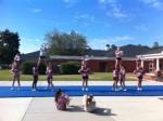 Cheer leaders practice hard.