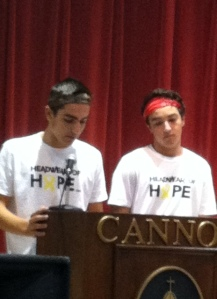 Chad and Andre talk to the student body about Head Wear for Hope during community meeting