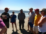 Freshmen Chaperones planning games on the beach.