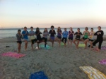 Freshmen rise early for yoga on the beach