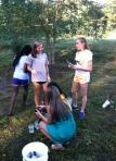 ladies discuss pond lab findings.