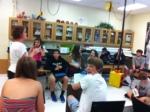 Mrs. Smith teaches freshmen physics concepts.
