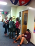 Students eagerly wait for PSAT doors to open.