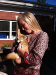 Embracing a fox that was brought for a junior k program last week.