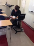 Student intent as he takes a test .
