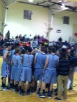Boys huddle to figure out plan to beat Queens  Grant.