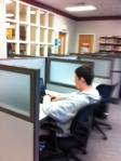 Devon uses time wisely in the library.
