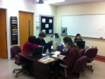 Mrs.Hurtado and Ms. Hoffman work i=with students in the conference room.