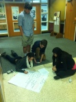 Students enjoy group work in the hallways of Cannon.