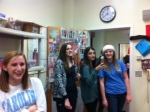 Sophomore girls enjoy watching Mr. Taylor's boys in their decorated classroom.