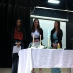 Paige Burton, Rachel Harris and Anna Redding take their Honor Society oath.