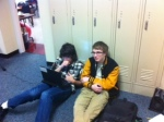 Sophomores George and Billy discuss world peace in the hall.