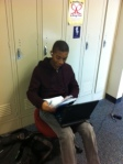 CJ works diligently in the hall.
