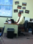 Mr. Campbell reads the blog to his boys.
