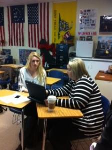 Ms. Eury joyfully works with students.
