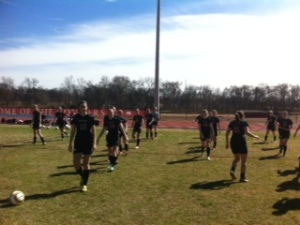 Warm ups before soccer scrimmage.