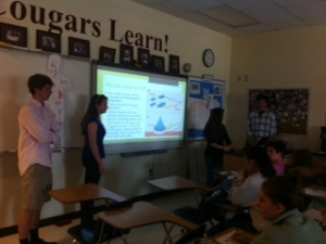 Biology students discuss their findings.