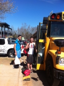 Athletes board bus for extra-curricular activities.