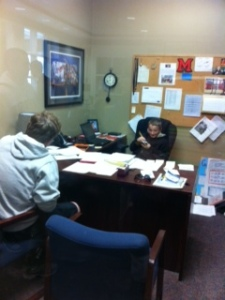 Looks like a fourth grader is really getting to know our athlete as he sits in Trojan's office.