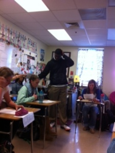 Dante helps hand out papers in English class.