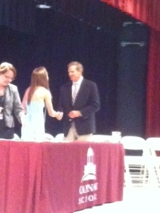 Mr. Gossage and Mrs. Otey congratulate Rachel.