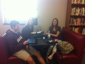 students hang in library just before the spring break.