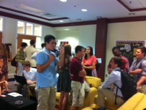 Groups gathered between Capstone presentations.