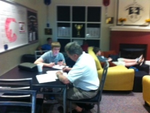 Parents help fill out Outward Bound forms .