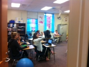 Students actively engaged in math class.