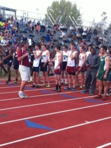 Coach Campbell gets boys ready to race.