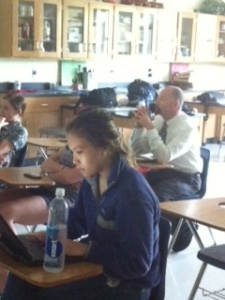 Mr. Booker sits with students and discusses advancements in technology.