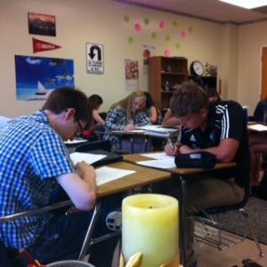 Students peer revise dystopian papers.