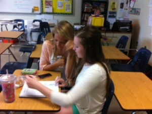 Students working a math problem.