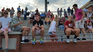 Seniors support football scrimmage.