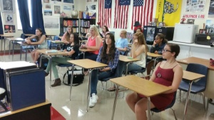 Students happily listen to Ms. Eury early in the morning.