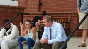 Mr. Gossage hangin with the upper school students during car line.