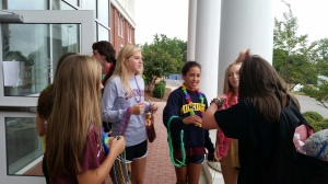Spirit club gave out beads and flowers to students... wow! awesome.