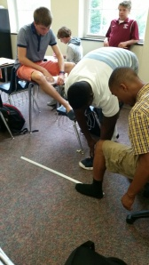 measuring each others feet to prove an algebra concept. What fun!