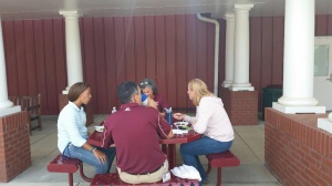 Faculty enjoy the quad during lunch.