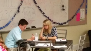 Mrs. Clarke and Rob work quietly in the Commons.