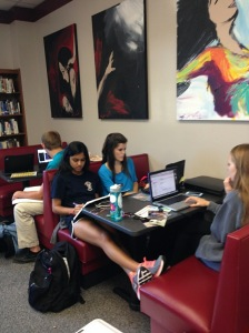 Seniors work in library.