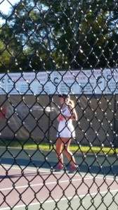 Tennis player takes the court.