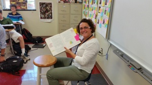 Mrs. Zelaya sits in her little chair and gives lbig lessons.