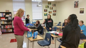 College counselor McClanahan brought donuts to Mrs. Clarke's Advisory so she could break bread with her freshmen friends.