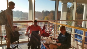 Seniors enjoy the sunny morning spot.