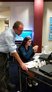 Mr. Coggins and Anna work hard to figure out the science of the new  fish tank.