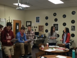 A group of talented vocalist gathered yesterday at 7:15 to practice singing  Holiday music.