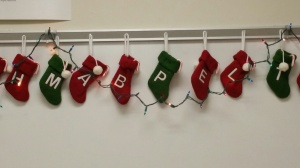 The stockings were hung by the white board with care.