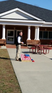 Mr. Coggins and gang play cornhole during student choice.